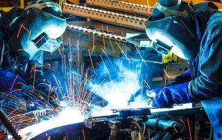 Welders working in a shipyard